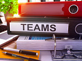 Teams on Black Office Folder. Toned Image. 3D Rendering.