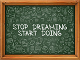 Hand Drawn Stop Dreaming Start Doing on Green Chalkboard.
