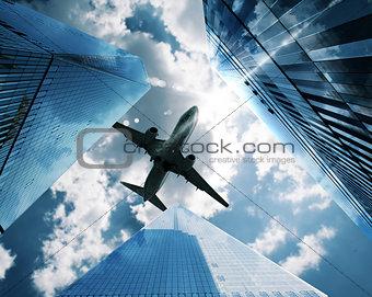 Aircraft between skyscrapers