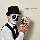 man with mexican calaveras makeup and skull, and text happy hall