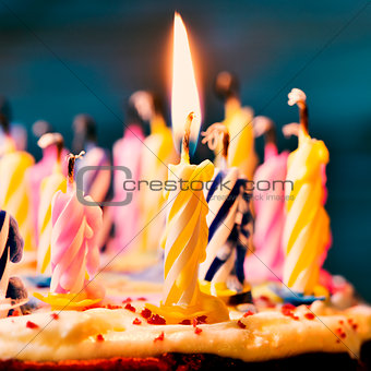 blowing out the candles of a cake