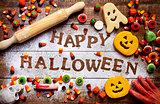 candies, cookies and text Happy Halloween