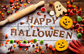candies, cookies and text Happy Halloween