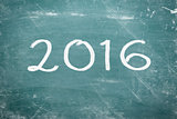 Happy new year 2016 written on chalkboard.