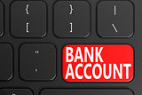 Bank account on black keyboard