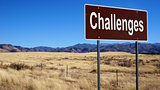 Challenges brown road sign