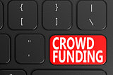 Crowd Funding on black keyboard