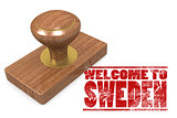 Red rubber stamp with welcome to Sweden