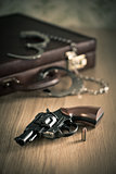 Handcuffs and revolver