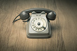 Vintage telephone on hardwood surface