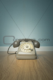 Gray vintage phone on the floor