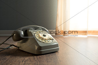 Gray telephone on hardwood floor