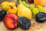 assorted bio summer fruits on the wooden table