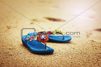 Beach flip flops on tropical sandy coast