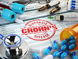 Crohns disease diagnosis. Stamp, stethoscope, syringe, blood tes