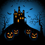 Halloween blue night with haunted castle and grinning pumpkins