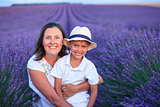Boy with his mother in lavender summer field