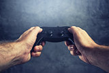 Man using gamepad controller to play video games