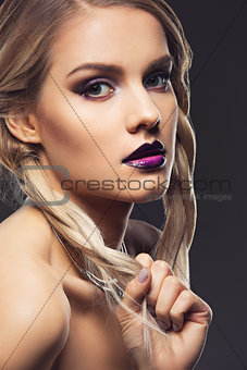 Beautiful girl with dark purple lips