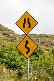 Winding road and bottleneck signs