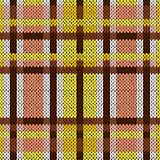 Seamless knitted pattern in brown, yellow and white