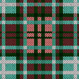 Seamless knitted pattern in red, green, turquoise and white