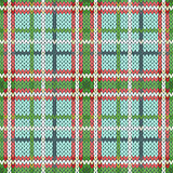 Seamless knitted pattern in green, red and white hues