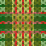 Seamless knitted pattern in green and red hues