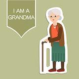 Grandma standing full length with walking stick smiling