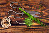 Fresh and dry chives on wooden table.