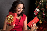 Woman opening a gift box.Christmas season