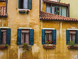 Vintage window of a house near the canal in Venice