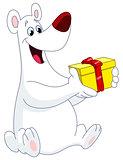 Polar bear holding gift
