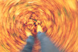 Motion Blur Walking in Autumn Fall Leaves