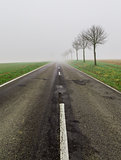 Road in fog leads to nothing
