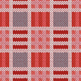 Knitting seamless pattern in red, pink and grey colors