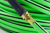 Garden hose brass nozzle attached close-up