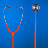 Orange stethoscope headset and bell closeup isolated on blue bac