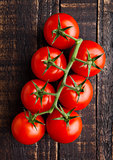 Fresh organic tomatoes on grunge wooden background