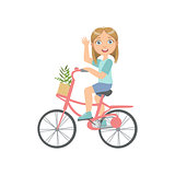 Girl Riding A Bicycle Waving