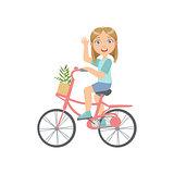 Girl Riding A Bicycle Waving