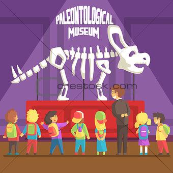 Groop Of School Kids In Paleontology Museum Next To Triceratops Skeleton