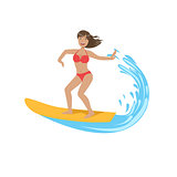 Woman In Red Bikini Riding A Wave On Surf