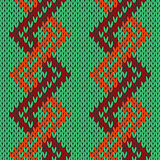 Knitting seamless zigzag pattern in green, orange and brown