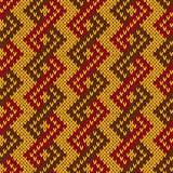 Knitting seamless zigzag pattern in muted warm colors