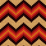 Knitting seamless zigzag pattern in warm colors