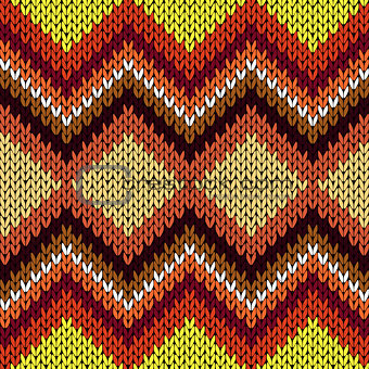 Knitting seamless zigzag pattern in warm hues
