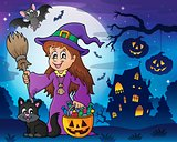 Cute witch and cat in Halloween scenery