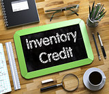 Inventory Credit on Small Chalkboard. 3D Illustration.