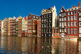 The dancing houses at Amsterdam canal Damrak, Holland, Netherlands.